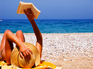 girl-reading-on-beach-md